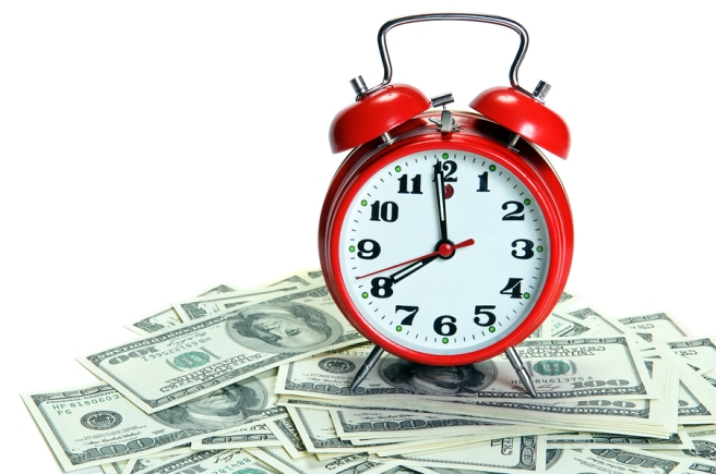 Red alarm clock on money - Time is money concept. Space for your text